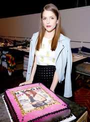 Anna Kendrick attended Nylon's celebration of her February cover wearing a pastel-blue IRO moto jacket over a Tory Burch pineapple-print top.
