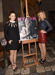 Kaitlyn Dever went for retro coolness in a black shift dress with multiple cutouts on the yoke during Nylon's celebration of Chloe Grace Moretz's cover.
