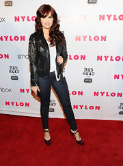 Debby Ryan hit the red carpet at the 'Nylon' magazine 13th anniversary celebration wearing a pair of deep burgundy patent leather pumps with ankle straps.