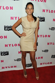 Genesis Rodriguez's tan showed through a nude bandage dress at a Nylon Magazine party.