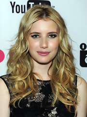 Emma Roberts lit up the red carpet at NYLON Magazine's issue party with center part curls that softly framed her face.