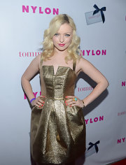 Francesca Eastwood swept on hot coral nail lacquer to complement her smokin' gold gown.
