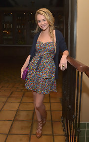 Britt Robertson looked all set for summer in her floral dress and tan strappy sandals.