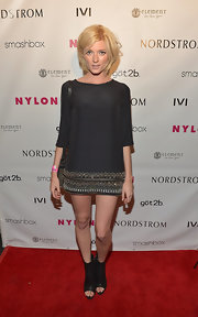 Sophie Sumner chose this trapeze-style black dress with an embellished hem for her mod-inspired red carpet look.