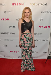 Claudia Lee chose a rosebud floral maxi skirt to soften up her leather crop top.