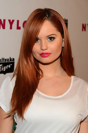 Debby Ryan opted for a bold beauty look with this hop pink lip color.