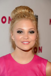 Olivia Holt chose this high bun for her ballerina-inspired beauty look.
