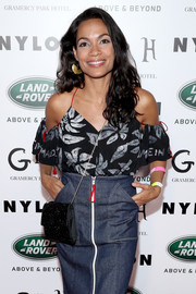 Rosario Dawson gave her casual outfit an elegant finish with a sparkly velvet bag when she attended Nylon's Rebel Fashion party.
