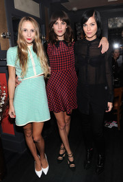 Alexa Chung chose a cute red and black plaid dress for the Nylon October issue party.