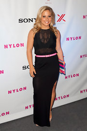 Shawn Johnson paired a sheer blouse with a long black skirt featuring a thigh-high slit for a sophisticated finish.