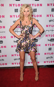 Alyson looked sweet and sexy in a floral-printed mini dress with wild flowing curls and natural makeup.