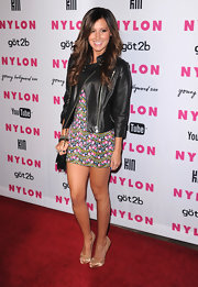 The actress mixed sweet and sexy by topping off her floral mini dress with a black leather motorcycle jacket.