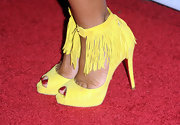 Christina is not afraid to make a statement. The new mom stepped onto the red carpet sporting a pair of vibrant yellow fringe heels.