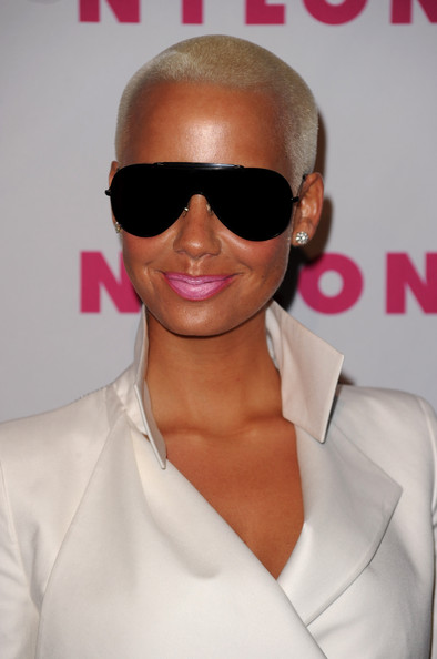 Amber paired her structured white blazer with bold black shades.