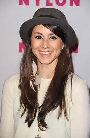 Troian Bellisario dressed up her simple outfit with a dangling feathered earring when she attended the Young Hollywood party.
