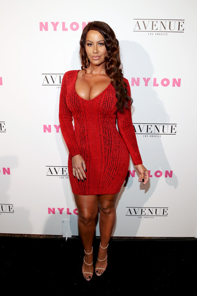 Amber Rose sealed off her sexy look with cream-colored triple-strap heels.