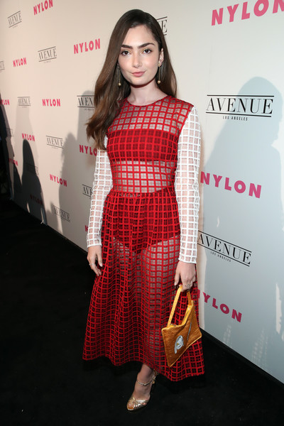 Emily Robinson flashed some flesh in a sheer red Shrimps dress with contrast sleeves at the Nylon Young Hollywood party.