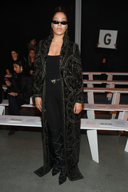 La La Anthony was diva-glam in an embellished black opera coat by Naeem Khan during the label's Fall 2018 show.