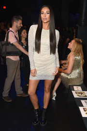 Shay Mitchell struck a pose at the Naeem Khan show wearing a micro-beaded white dress from the label.