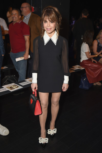 Paula Abdul attended the Naeem Khan fashion show wearing a little black dress with sheer sleeves and a contrast collar and cuffs.