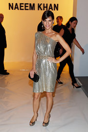 Perrey Reeves showed off a sparkling cocktail dress while hitting the Naeem Khan fashion show.
