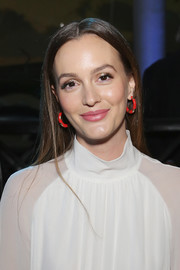 Leighton Meester dolled up her look with a pair of heart-adorned enamel hoops by Alison Lou.