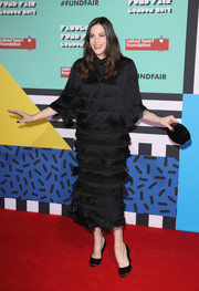 Liv Tyler struck a pose on the Fabulous Fund Fair red carpet wearing a fringed LBD by Stella McCartney.