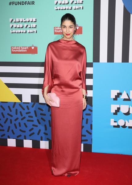 Caroline Issa went for playful styling with a pale pink lip clutch.