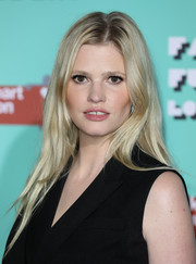 Lara Stone attended the Naked Heart Foundation's Fabulous Fund Fair wearing her hair in a loose center-parted style.