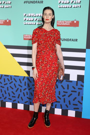 Erin O'Connor went the demure route in a red floral frock by Christian Dior at the Naked Heart Foundation's Fabulous Fund Fair.