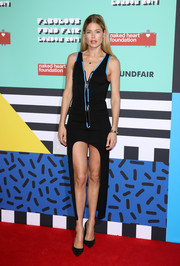 Doutzen Kroes paraded her killer legs in a black Louis Vuitton mini dress with side mullets at the Naked Heart Foundation's Fabulous Fund Fair.