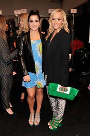 Nastia Liukin paired a feminine dress with an edgier leather jacket for a fun look at the Nanette Lepore runway show.
