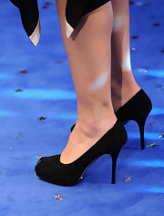 Actress Maggie Gyllenhaal wore a simple pair of suede pumps while attending a world film premiere. Her pumps were a safe choice to accompany her black dress.