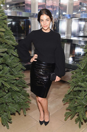 Julia Restoin-Roitfeld went edgy-sexy on the bottom half in a black vinyl pencil skirt.