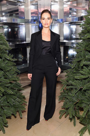 Lily James went masculine-chic in a black pantsuit at the 'Close Your Eyes and Think of Christmas' event.