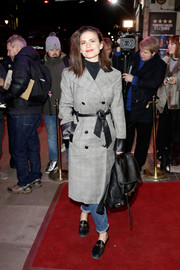 Hayley Atwell donned a gray glen plaid coat with a leather belt and cuffs for the 'Good Girl' photocall.
