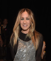 Sarah Jessica Parker sat front row at the Narciso Rodriguez fashion show wearing her usual center-parted style.