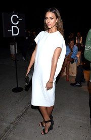 Jessica Alba was minimalist-chic in a loose white midi dress by Narciso Rodriguez while attending the brand's fashion show.