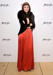 Sophia Amoruso looked super glam in a fur-trimmed jacket layered over a red gown at the Nasty Gal Melrose store launch.