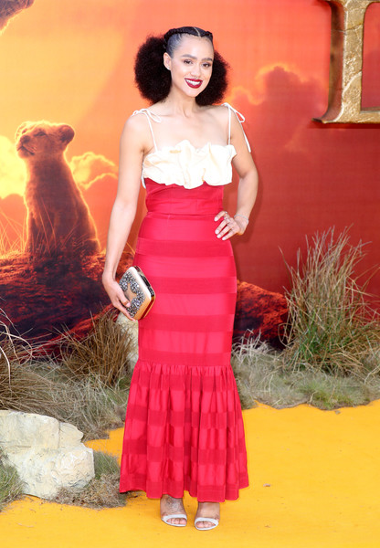 Nathalie Emmanuel Gemstone Inlaid Clutch [the lion king,clothing,dress,red,waist,lady,pink,fashion,shoulder,formal wear,orange,european premiere,nathalie emmanuel,european,england,london,leicester square,red carpet arrivals,premiere]