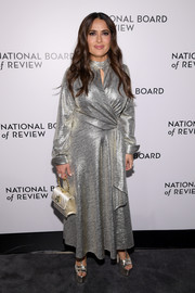 Salma Hayek matched her frock with a pair of sky-high platform sandals by Gucci.