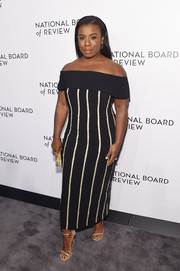 Uzo Aduba paired her dress with gold slim-strap sandals by Stuart Weitzman.