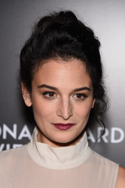 Jenny Slate polished off her look with a sweep of berry lipstick.