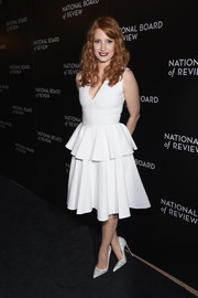 Jessica Chastain matched her frock with embellished white pumps by Christian Louboutin.