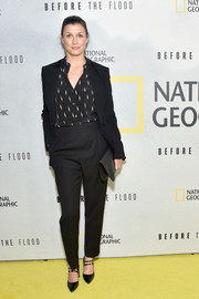 Bridget Moynahan completed her business-chic attire with a pair of black double-strap Mary Janes.