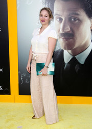 Erika Christensen kept it simple in a white cap-sleeve button-down at the premiere of 'Genius.'