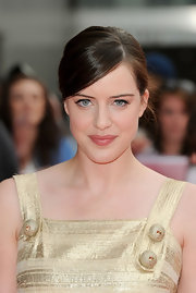 Michelle Ryan paired her gold metallic dress with a classic bun.