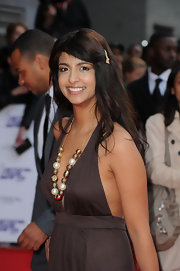 Konnie Hug paired her haltered dress with a gold beaded necklace.