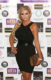 Nicola McLean's long blonde locks looked like a doll's in a braided 'do at the National Reality TV Awards.
