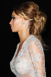 Lauren Pope wore her hair in a voluminous textured ponytail at the 2012 National Television Awards in London.